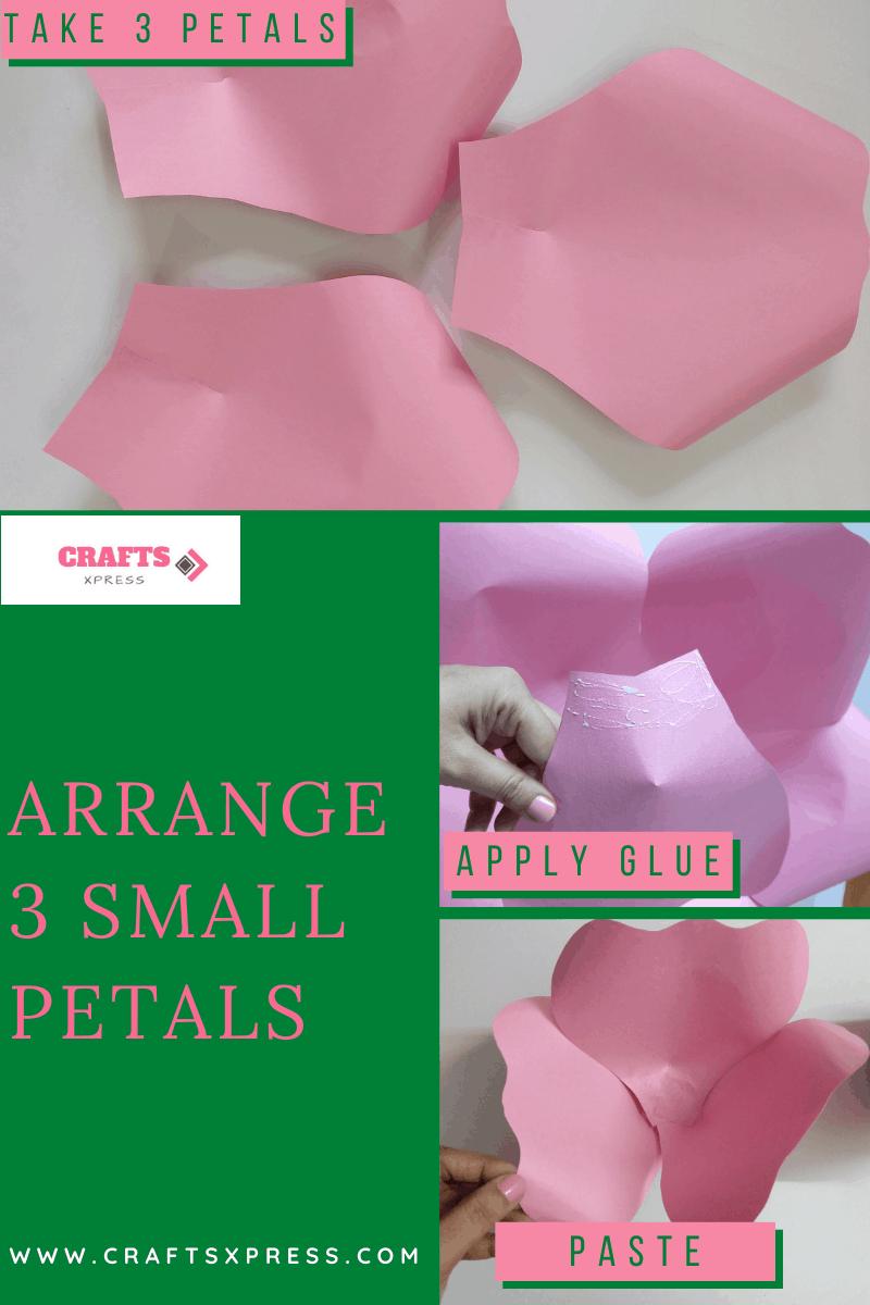 Arrange three small petals to the rose center