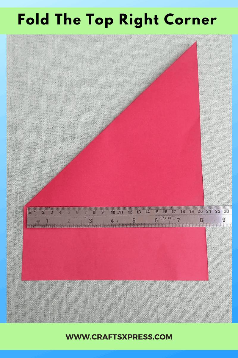 Fold the top right corner